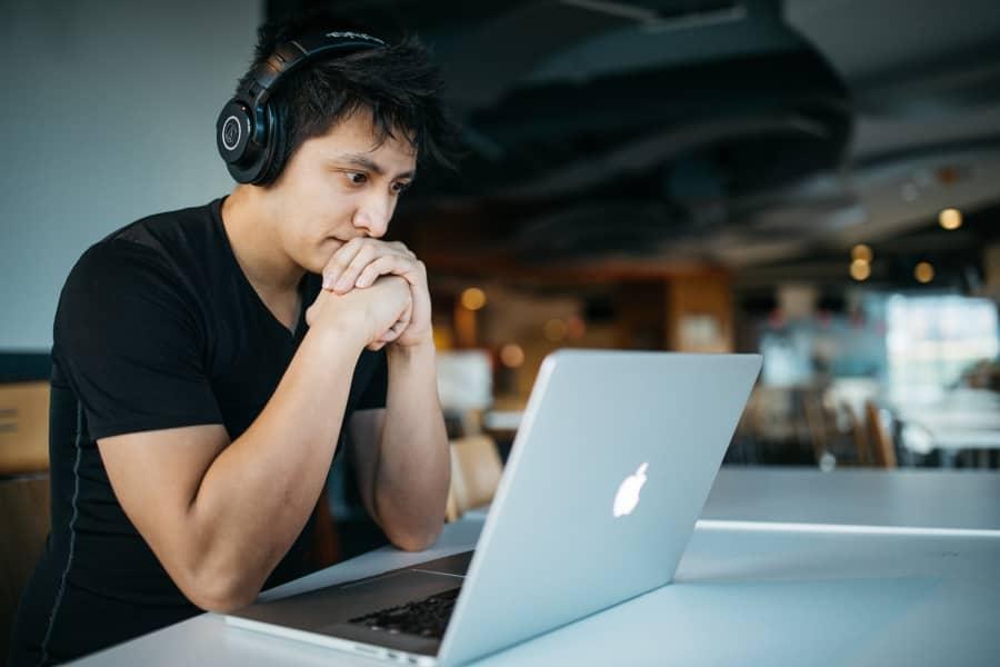 Man sitting at a laptop